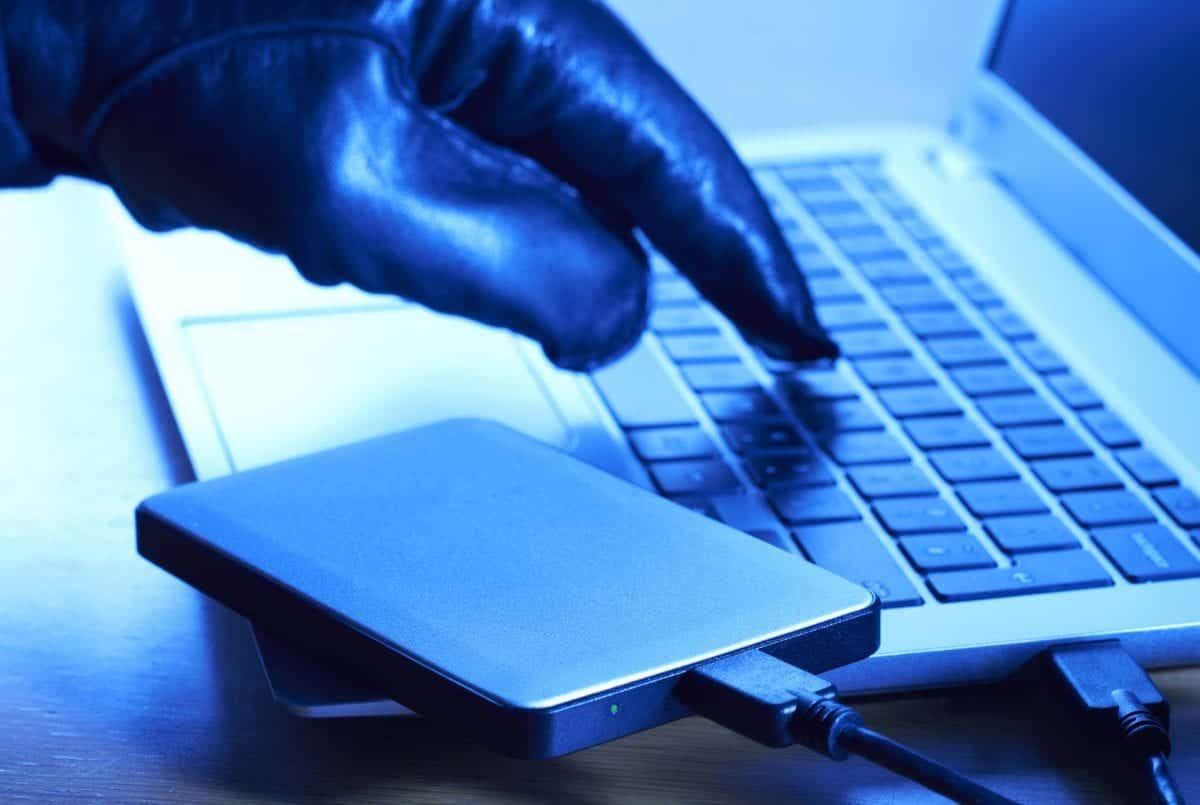 Protect your Privacy cyber criminal downloading data onto portable hard drive