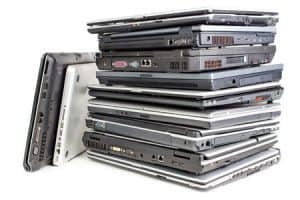 Big Pile of laptops for safe recycling and data destruction